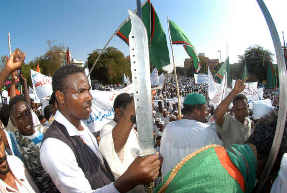 A Sudanese demonstrator carries a sword as he takes part a protest today in Khartoum. Photo: CHARLES ONIANS, AFP/Getty Images
