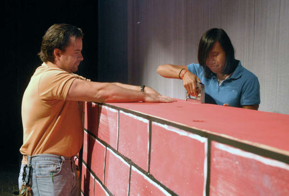 The Woodlands High School technical theater instructor Tim Jackubek helps 11th grade student Malee Knighthill put the finishing touches on a prop for an upcoming production. Photo: David Hopper, For The Chronicle