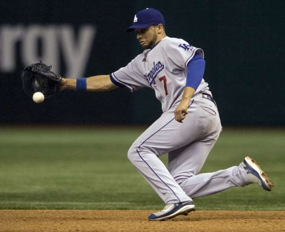 Former Elkins star James Loney makes a play at first for the Dodgers against the Devil Rays. He also has played outfield this season. Photo: Steve Nesius, AP