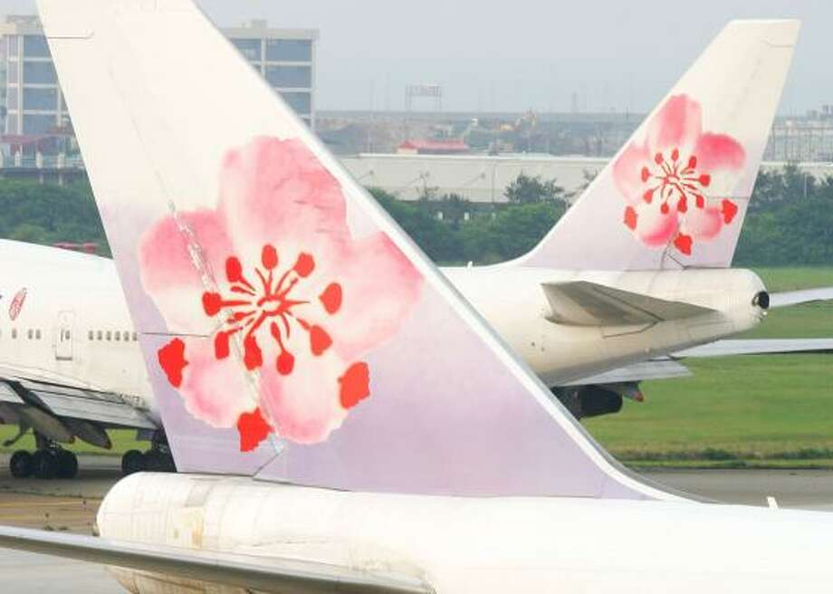 China Airlines, whose jets are shown at its hub in Taipei, Taiwan, will keep cargo service to Houston. Photo: MAURICE TSAI, BLOOMBERG NEWS FILE