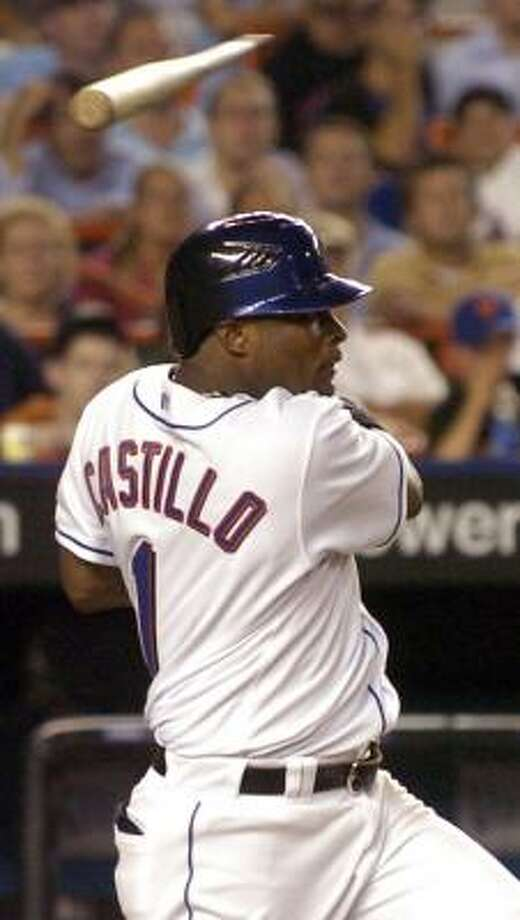 The Mets' Luis Castillo's bat breaks, but he has to like the result — a two-run single. Photo: DAVID L. POKRESS, MCT
