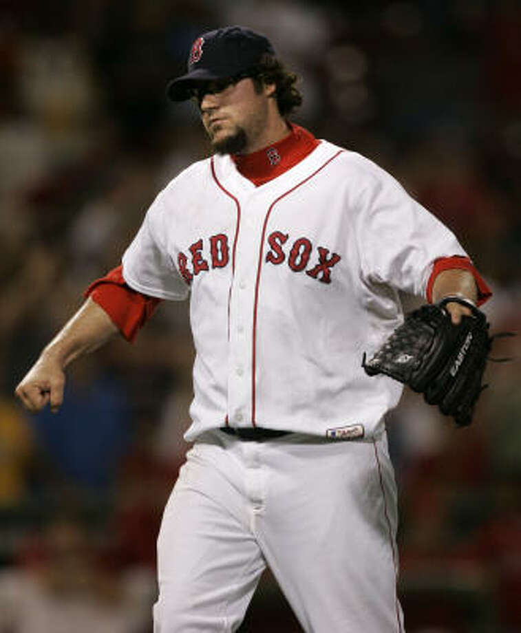 Red Sox reliever Eric Gagne reacts after giving up three runs in the ninth inning of a 7-5 Angels win in the nightcap of a doubleheader at Fenway Park. Photo: Charles Krupa, AP