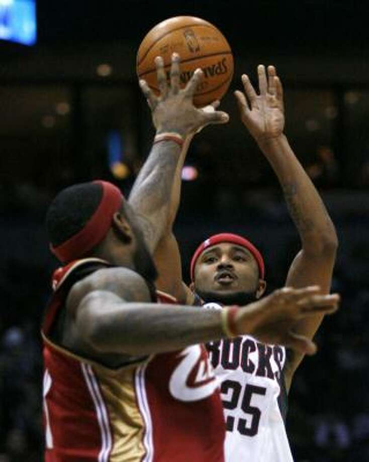 On his way to a 37-point performance, the Bucks' Mo Williams shoots over LeBron James. Photo: DARREN HAUCK, ASSOCIATED PRESS