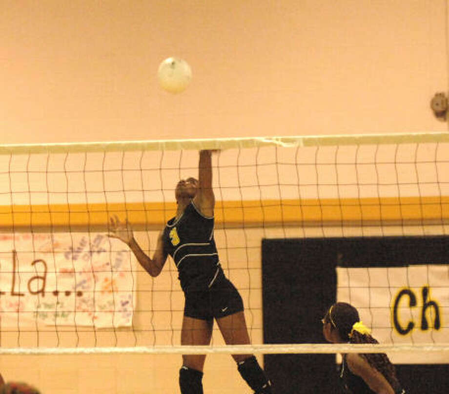 Eisenhower's Karensa Beckford hits and scores  over an unguarded Westfield net. Photo: Eddy Matchette, For The Chronicle