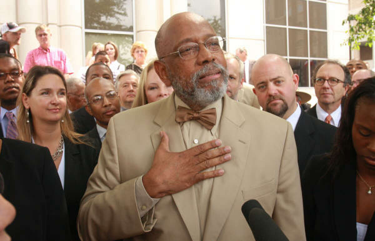 Former U.S. Rep. Craig Washington was accompanied by fellow lawyers outside the criminal courthouse in downtown Houston as he declared his innocence and pledged to fight an aggravated assault charge.