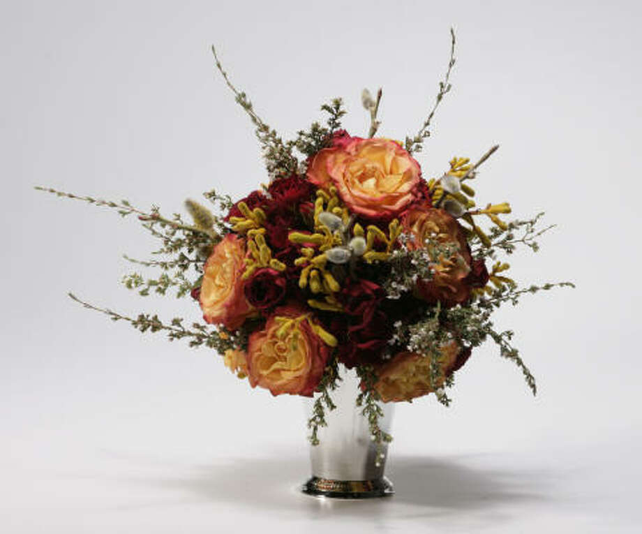 Vase with 'circus' roses at J. Aubrey Sellers. Photo: Buster Dean, Chronicle