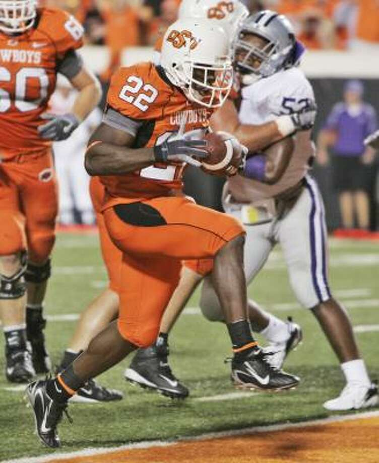 Oklahoma State running back Dantrell Savage runs in for a touchdown in the Cowboys' win over Kansas State. Photo: Sue Ogrocki, AP