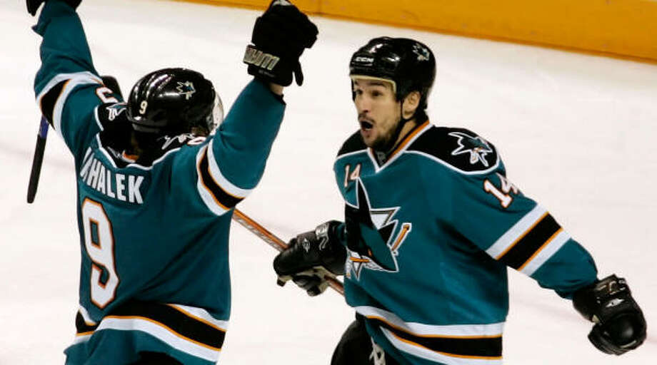 The Sharks' Jonathan Cheechoo, right, celebrates with teammate Milan Michalek after a third period goal. Photo: Christian Petersen, Getty Images