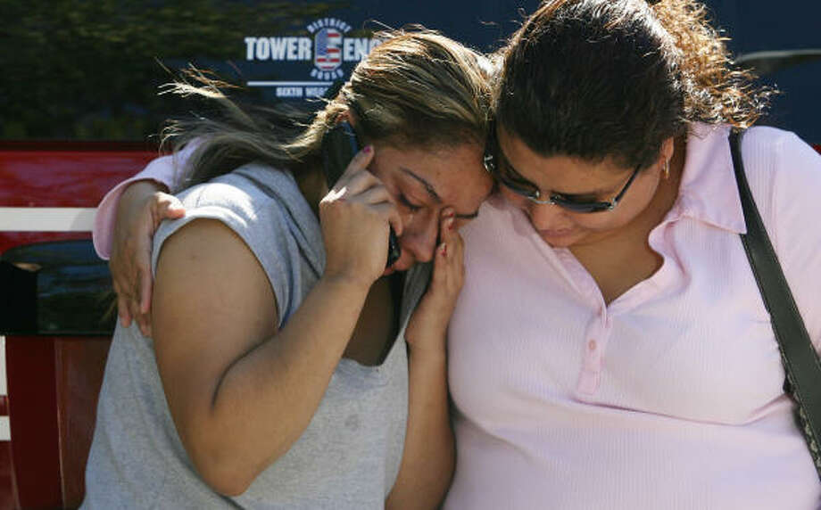 Dellanria Zapata weeps as friend Maria Nava consoles her outside their burned apartment after a duplex fire on Everett and Harrington that caused four families to be displaced after a fire possibly started by a lit candle moved to the second floor on Thursday in Houston. No one was injured. Photo: Mayra Beltran, Chronicle