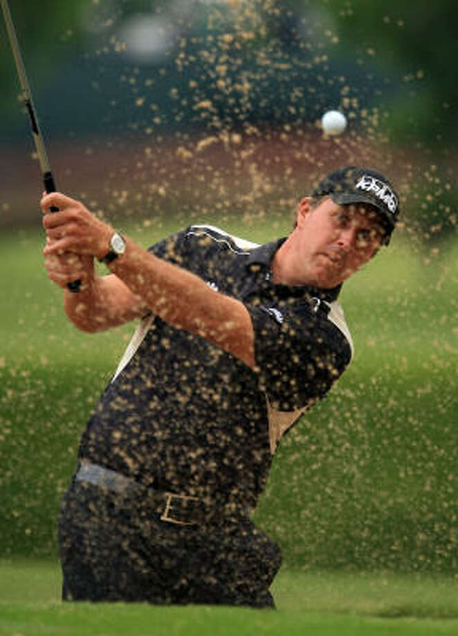Phil Mickelson plays a bunker shot on the 10th hole during the second round of the Crown Plaza Invitational at the Colonial Country Club on Friday in Ft. Worth. Photo: Scott Halleran, Getty Images