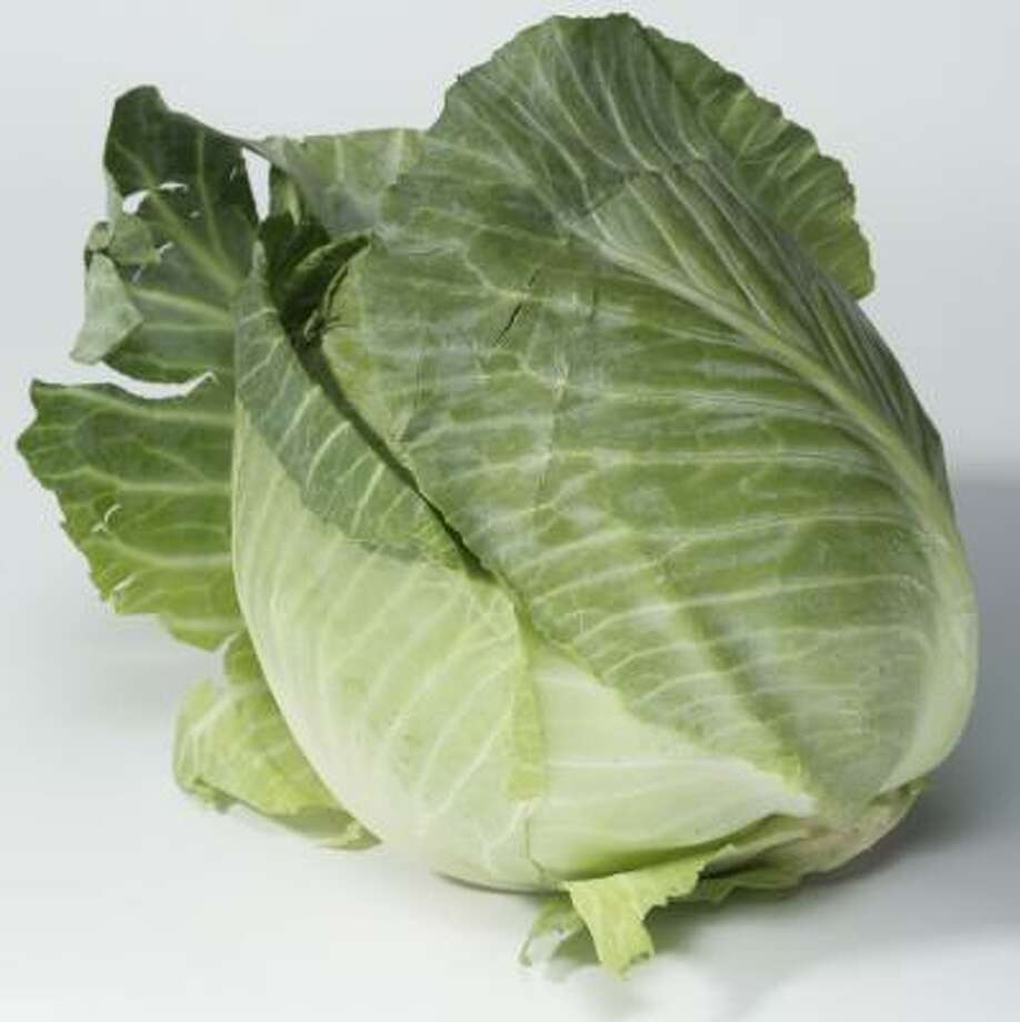 Cabbage, says the Environmental Working Group, has much less exposure to pesticides than lettuce. Photo: BUSTER DEAN, CHRONICLE