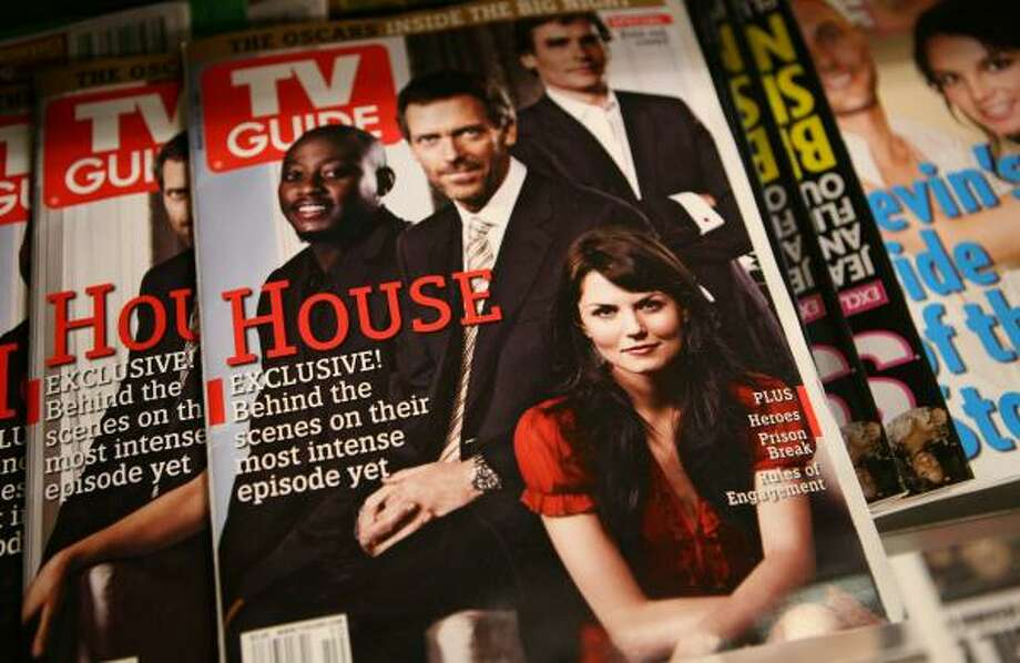 Issues of TV Guide are for sale at a New York newsstand. The magazine is part of a $2.8 billion sale. Photo: MARK LENNIHAN, ASSOCIATED PRESS FILE
