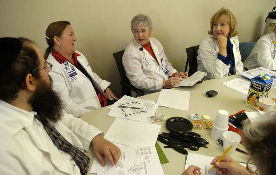 Lazer Lazaroff, Linda Shiflett, Barbara Carmichael and Nancy DeForest participate in a discussion during a pastoral care program training session at St. Luke's Community Medical Center in The Woodlands. Photo: Jerry Baker, For The Chronicle