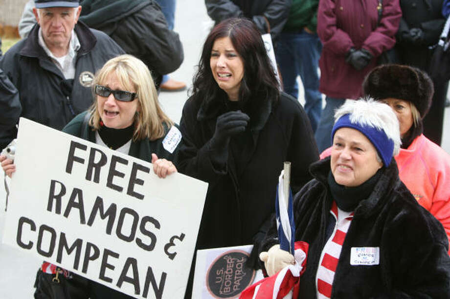 More than 40 family members and supporters of former U.S. Border Patrol agents Ignacio Ramos and Jose Alonso Compean show their support Wednesday in Washington. The two were convicted of shooting a Mexican drug smuggler and trying to cover it up in 2005. Photo: Ruben R Ramirez, El Paso Times