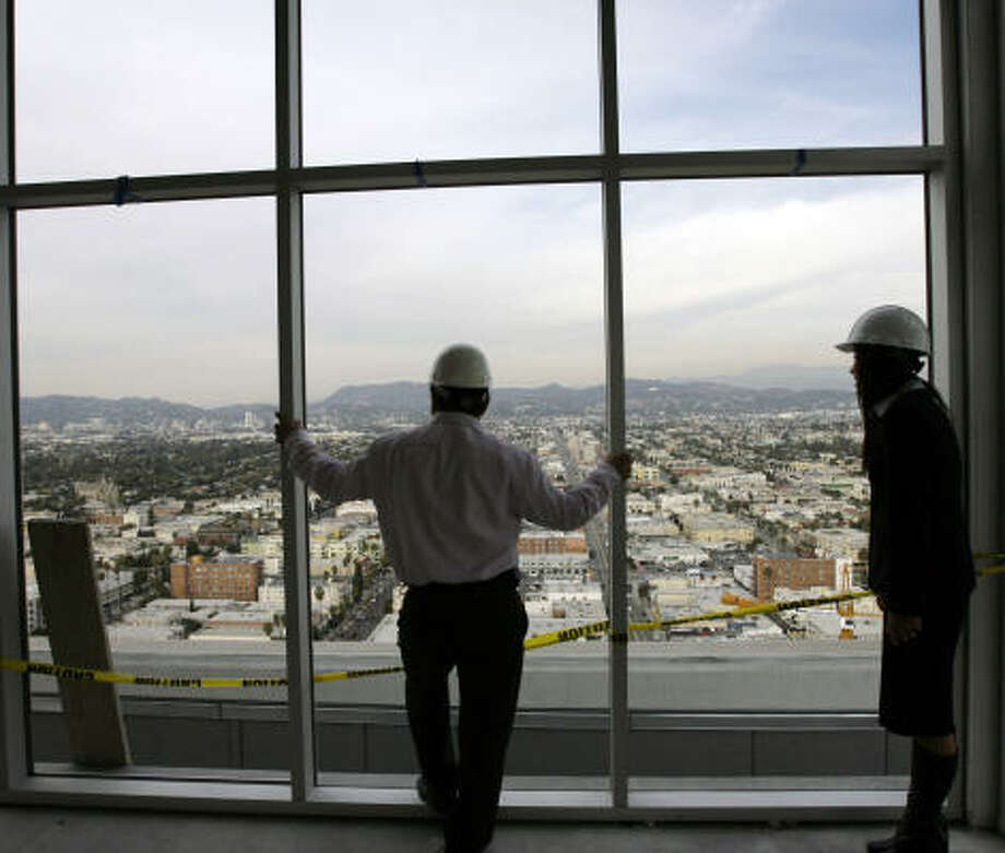 South Korean investor Michael Chang, left, looks over the Koreatown area of Los Angeles from the Mercury condominium complex. Photo: DAMIAN DOVARGANES, AP