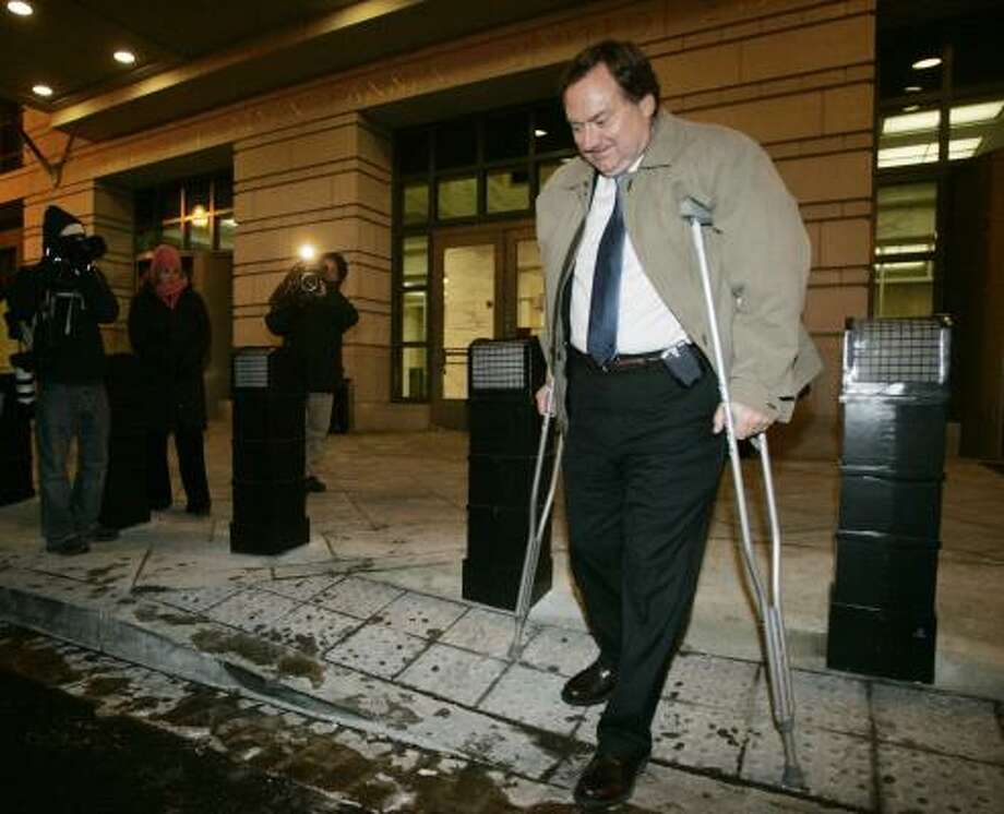 """Meet the Presshost Tim Russert leaves federal court Wednesday. The prosecution witness in the Lewis """"Scooter"""" Libby CIA leak trial was on crutches because of a broken ankle. Photo: PABLO MARTINEZ MONSIVAIS, ASSOCIATED PRESS"""