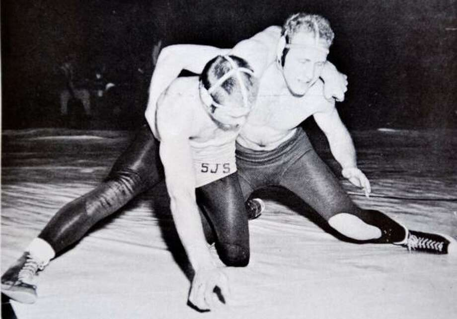 Kesey, right, was a star wrestler in the 1950s on Oregon's team, which will be cut after this season. Photo: HANDOUT PHOTO