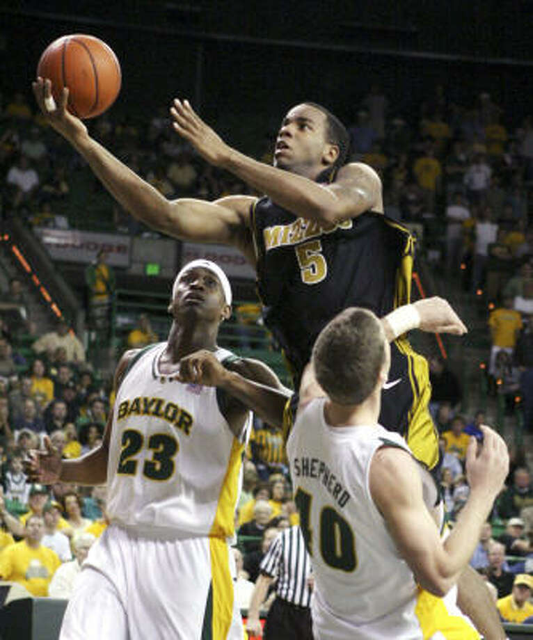 Missouri's Leo Lyons (5) shoots between Baylor defenders Kevin Rogers (23) and Mark Shepherd during the first half. Lyons scored a game-high 22 points in a losing effort. Photo: Nick Simonite, AP