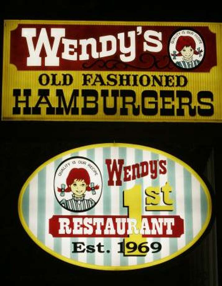 Signs at the original Wendy's restaurant are seen in this file photo from April 26, 2006, in downtown Columbus, Ohio. Photo: KIICHIRO SATO, ASSOCIATED PRESS