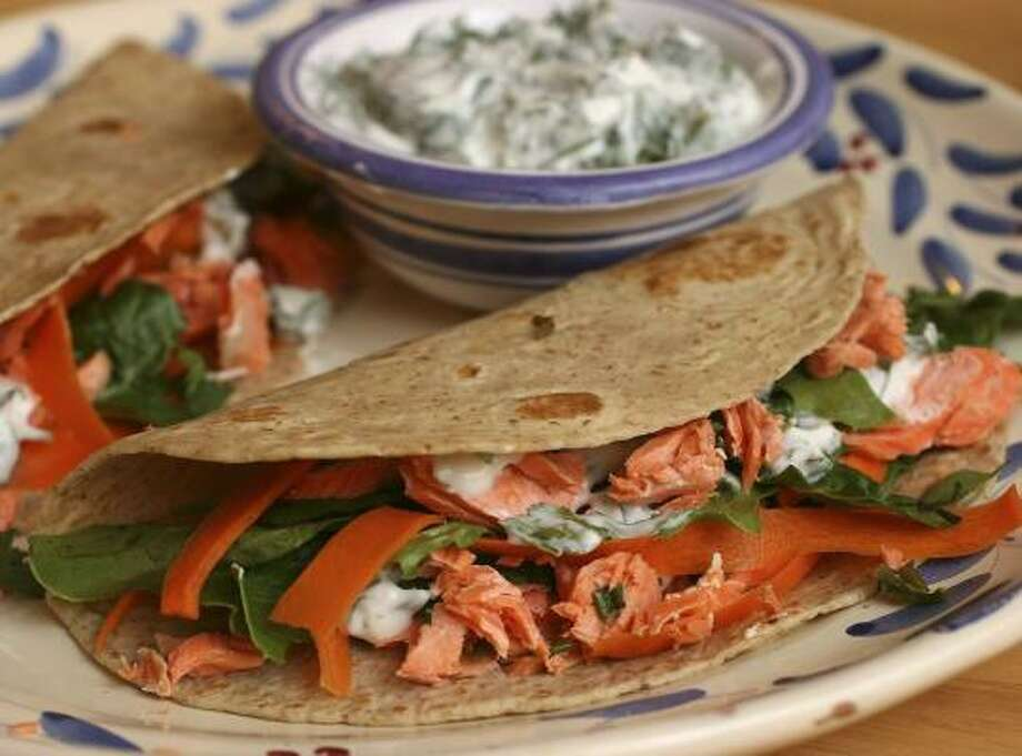 These salmon tacos, which contain just the right amount of good-for-you fats, are punched up with cilantro. Photo: LARRY CROWE, ASSOCIATED PRESS