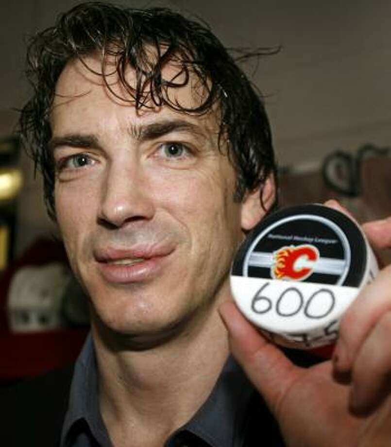 Colorado's Joe Sakic shows the puck commemorating his 600th career NHL goal after he scored twice and added three assists in the Avalanche's 7-5 victory at Calgary, Alberta. Sakic is the 17th player in NHL history to have 600 career goals. Photo: Jeff McIntosh, AP