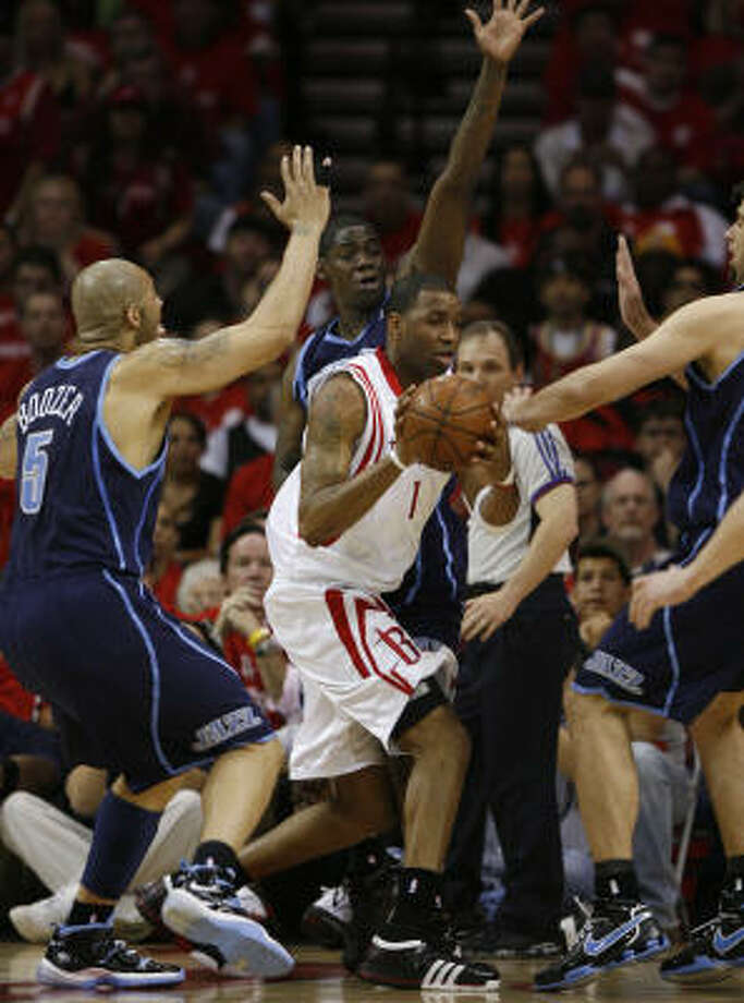 Rockets guard Tracy McGrady (center) is surrounded by Jazz defenders during the second quarter of Saturday's 93-82 playoff-opening loss. Photo: Brett Coomer, Chronicle