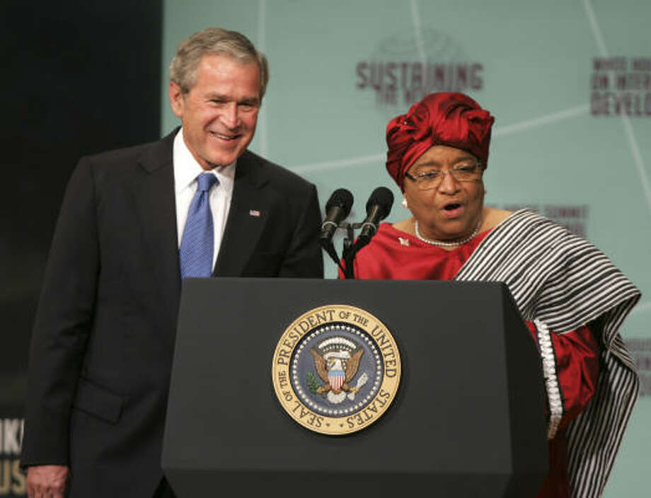President Bush stands with Liberian President Ellen Johnson Sirleaf, prior to making remarks at the White House Summit on International Development, Tuesday. Photo: Lawrence Jackson