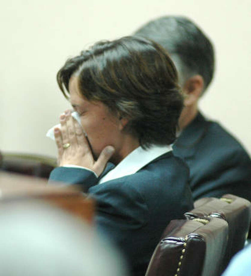 Mary Winkler reacts Thursday in Selmer, Tenn., during opening arguments in her trial. Winkler is charged with first degree murder in the March 2006 shooting death of her minister husband, Matthew Winkler, in the parsonage of their church. Photo: Russell Ingle, AP