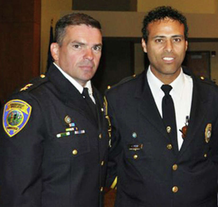 Fairfield Police Chief Gary MacNamara (at left) and Lt. James Perez, a Fairfield Police spokesman, are slated to appear on an episode of Dateline NBC this Sunday that focuses on a Connecticut scam victim. Fairfield's willingness to help a woman in Stratford eventually led to a Nigerian scammer being arrested in South Carolina. Photo: Contributed Photo / Fairfield Citizen contributed