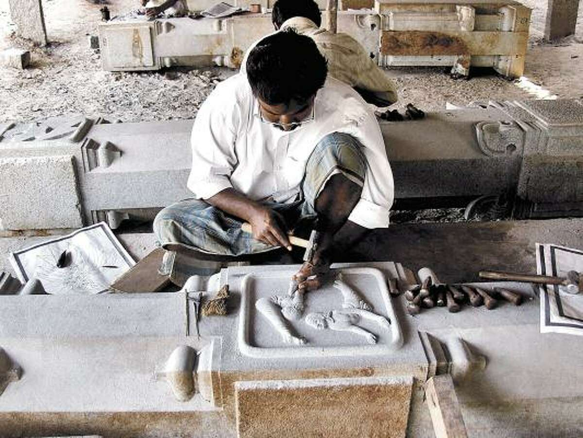 A Hindu mason, known as a shilpi, works on the Iraivan Temple in Kauai, Hawaii. Such workers may be forced to leave the U.S. if proposed changes to the religious-worker visa program are implemented.