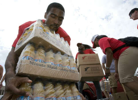 Luther Head loads supplies. He and the team helped out after Ike as they did after hurricanes Rita and Katrina. Photo: James Nielsen, Chronicle