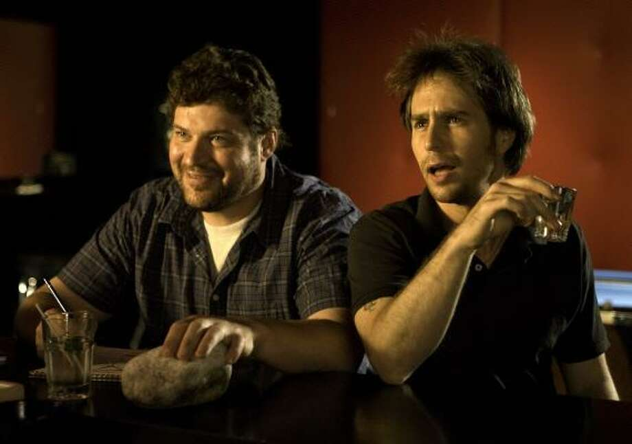 2008: Sam Rockwell, right, plays Victor, a sex addict with possibly divine parentage in Choke, based on a novel with the same name written by Chuck Palahniuk. During the day Victor works with Denny, played by Brad William Henke, right, as a tour guide. Photo: JESSICA MIGLIO, FOX SEARCHLIGHT PICTURES