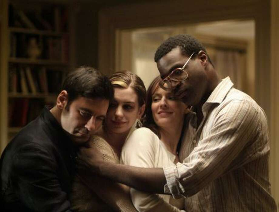 Mather Zickel as Kieran, from left, Anne Hathaway as Kym, Rosemarie DeWitt as Rachel and Tunde Adebimpe as Sidney portray a dysfunctional family dealing with ups and downs in Rachel Getting Married. Photo: BOB VERGARA, SONY PICTURES CLASSICS