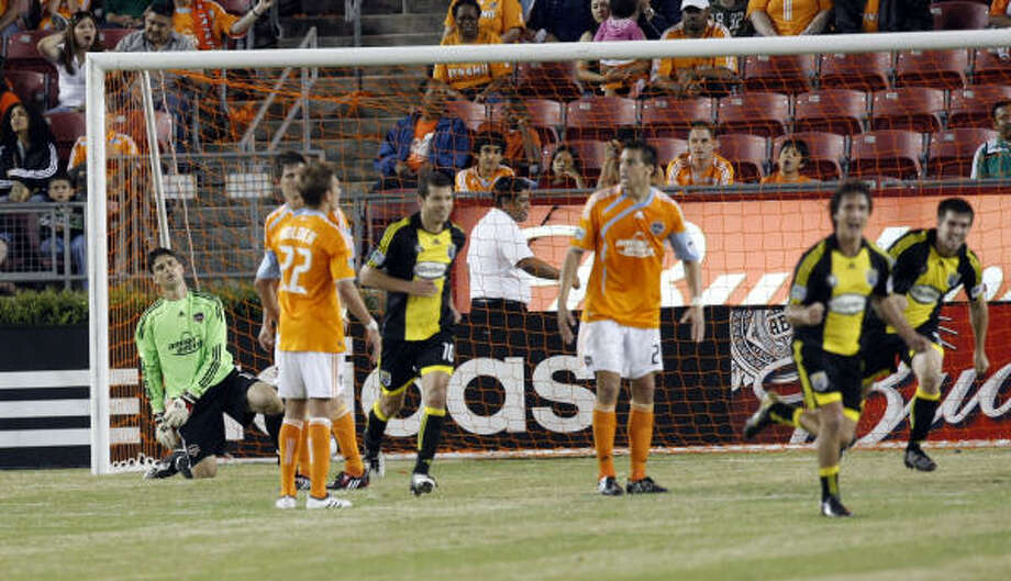 Dynamo goalkeeper Pat Onstad can only watch  after the Columbus Crew tied the game 1-1 in the 82nd minute thanks to a goal by reigning league MVP Guillermo Barros Schelotto, front right. Photo: Johnny Hanson, Chronicle