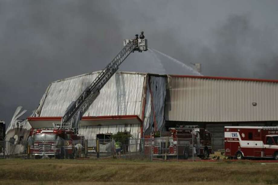 Firefighters battle a four-alarm blaza at the Ram Chemical and Supply warehouse on Greenhouse Road Saturday. Photo: Smiley N. Pool, Chronicle