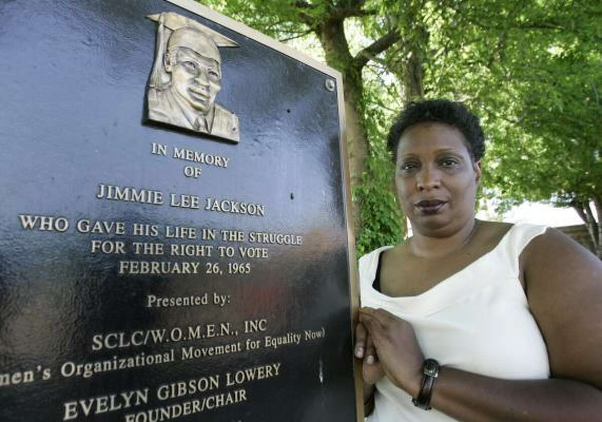 Cordelia Heard Billingsley visits a plaque honoring her father, Jimmie Lee Jackson. His death in 1965 sparked the Selma-to-Montgomery voting rights march and passage of the Voting Rights Act.