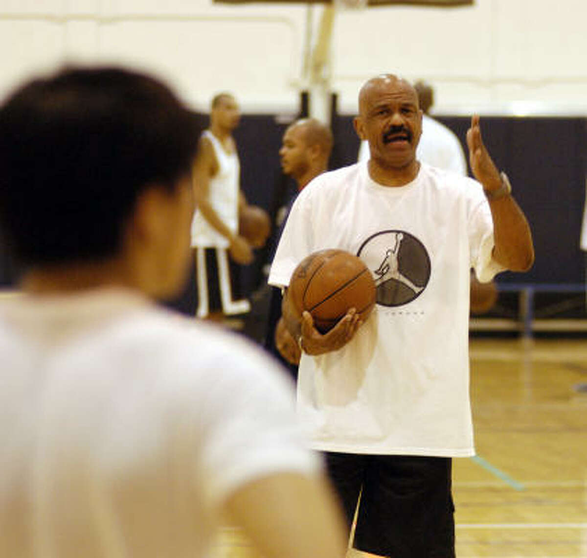Former Cavaliers coach John Lucas, seen here in 2003, pulls no punches when stressing basics at his summer camp.