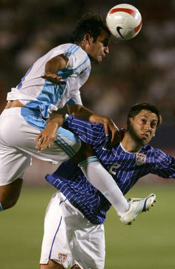Jose Contreras, left, of Guatemala beats U.S. midfielder Clint Dempsey to the header in Gold Cup tuneup action Wednesday night at Pizza Hut Park. Photo: Stephen Dunn, Getty Images