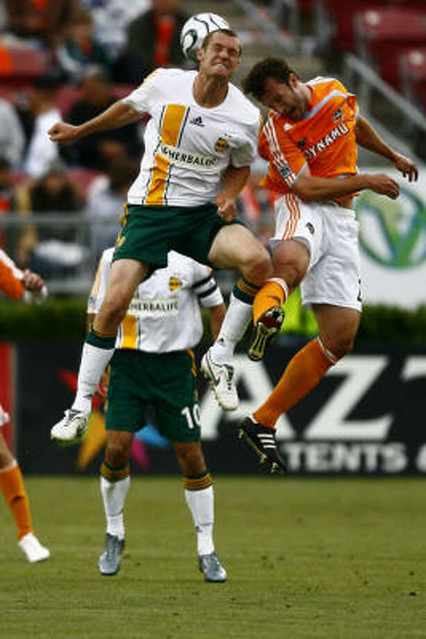 The Dynamo are hoping the addition Nate Jaqua, left, will help add some scoring punch to the lineup. Photo: Steve Ueckert, Chronicle