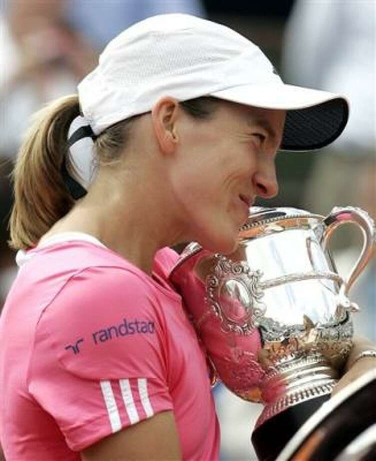 Justine Henin reached the final of every Grand Slam in 2006, then won the U.S. Open in 2007 (right). Photo: LIONEL CIRONNEAU, AP