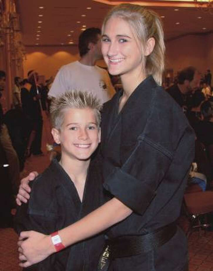 Sage Northcutt, 11, and Colbey Northcutt, 14, are world title holders in martial arts. Photo: Handout, NORTHCUTT FAMILY