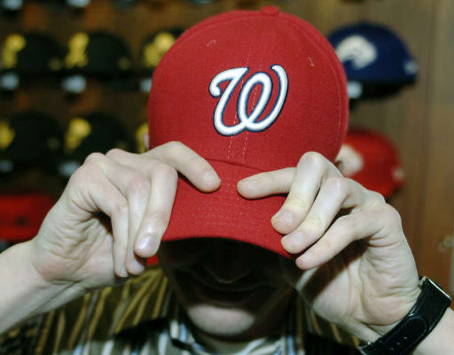 New Era Cap Co. employee Mike Wozniak models the new lid. Photo: Don Heupel, AP
