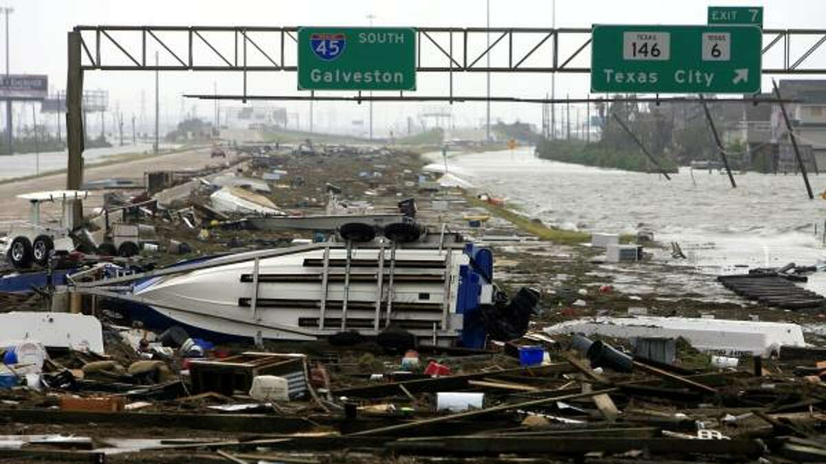 Ike left the southbound lanes of Interstate 45 heading into Galveston strewn with debris. The Island took the brunt of the storm's assault.