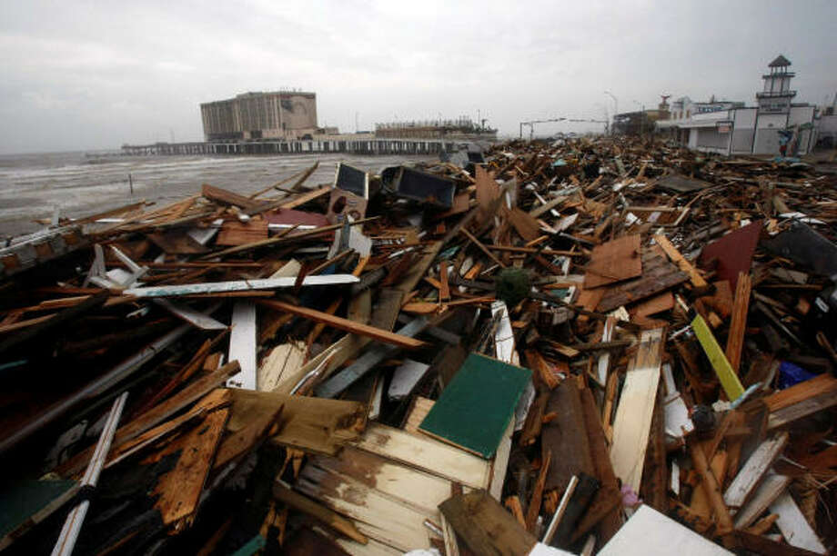 The remnants of Murdock's Pier and Hooters lay along Seawall Boulevard on Saturday. Photo: Johnny Hanson, Chronicle