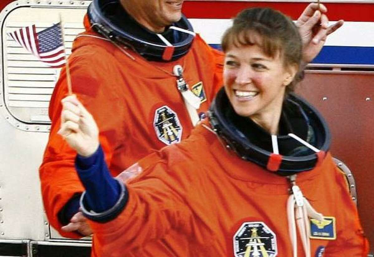 Lisa Nowak heads to Discovery for the 2006 liftoff at the Kennedy Space Center.