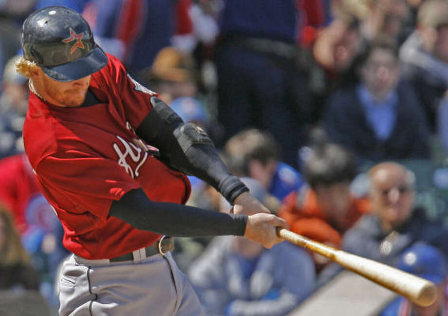 Houston's J.R. Towles hits a two-run home run against the Cubs. Photo: Nam Y. Huh, AP