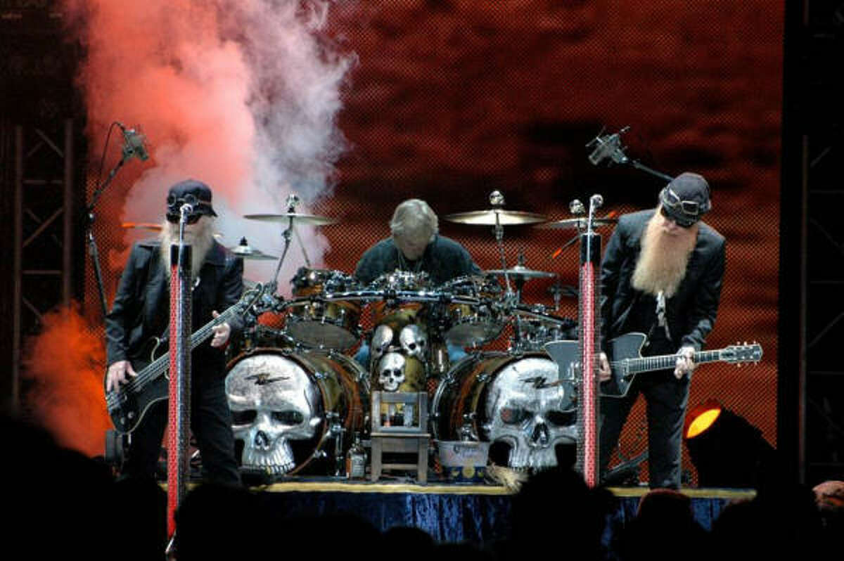 Beard, flanked by Dusty Hill, left, and Billy Gibbons, plays his most recent Douglas creation on ZZ Top's summer tour.