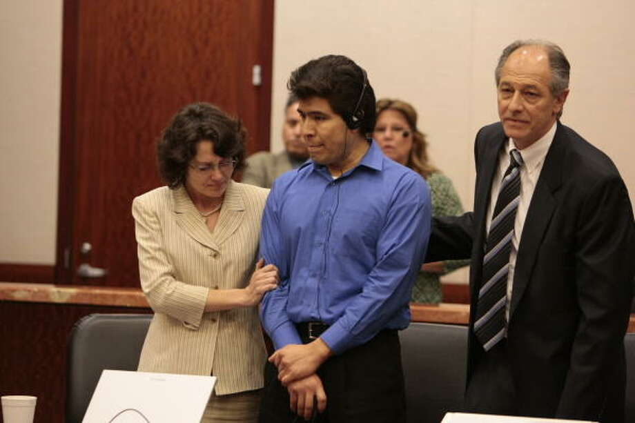 "Juan Leonardo Quintero, center, shown in court on Tuesday, had just one response after hearing the jury's decision: ""I'm sorry."" Photo: Billy Smith II, Chronicle"