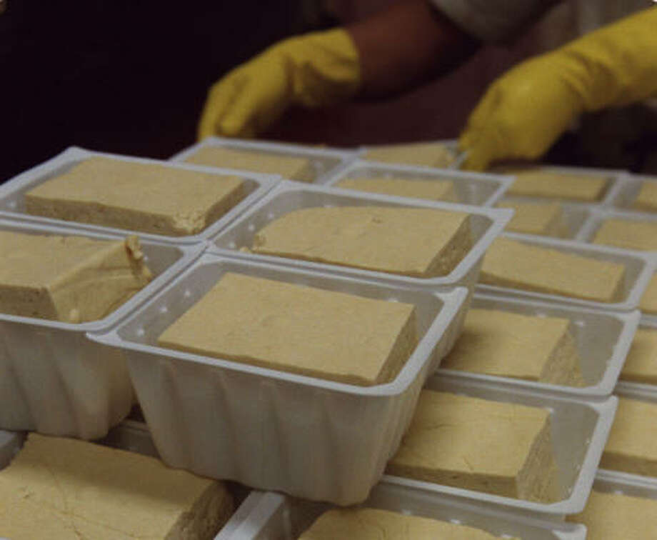Trays of fresh tofu are stacked at Banyan Foods. Photo: Steve Campbell, Chronicle