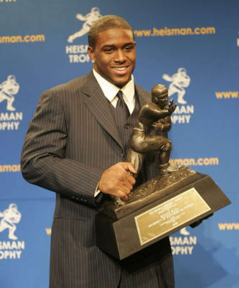 Reggie Bush had a firm grip on the Heisman Trophy  in December 2005, but some feel he should lose the award if it's shown he broke NCAA rules that would have made him ineligible that season. Photo: Gary Dunkin, For The Chronicle